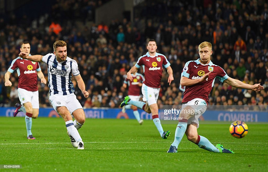 James Morrison of West Bromwich Albion shoots past Ben Mee of Burnley as he scores their second goal during the Premier League match between West Bromwich Albion and Burnley at The Hawthorns on November 21, 2016 in West Bromwich, England.