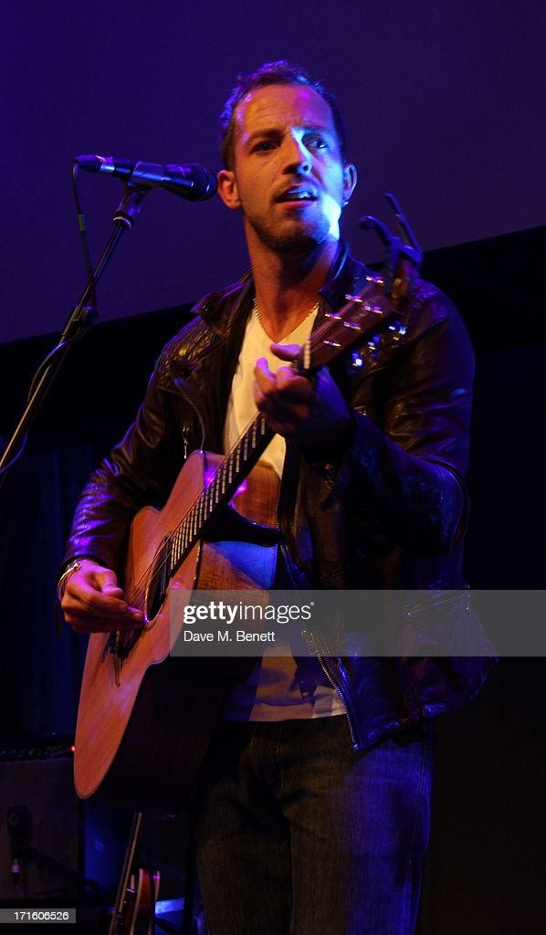 <a gi-track='captionPersonalityLinkClicked' href=/galleries/search?phrase=James+Morrison+-+Singer&family=editorial&specificpeople=4427605 ng-click='$event.stopPropagation()'>James Morrison</a> performs at the F1 Party in aid of great ormond street hospital childrens charity at Old Billingsgate Market on June 26, 2013 in London, England.