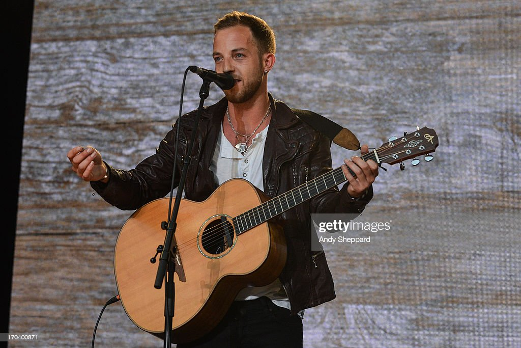 James Morrison performs on stage in support of One campaign's Agit8 event at Tate Modern on June 12, 2013 in London, England.