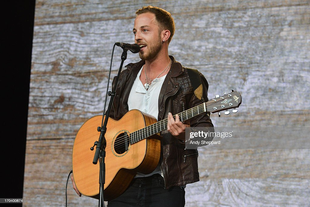 <a gi-track='captionPersonalityLinkClicked' href=/galleries/search?phrase=James+Morrison+-+Singer&family=editorial&specificpeople=4427605 ng-click='$event.stopPropagation()'>James Morrison</a> performs on stage in support of One campaign's Agit8 event at Tate Modern on June 12, 2013 in London, England.
