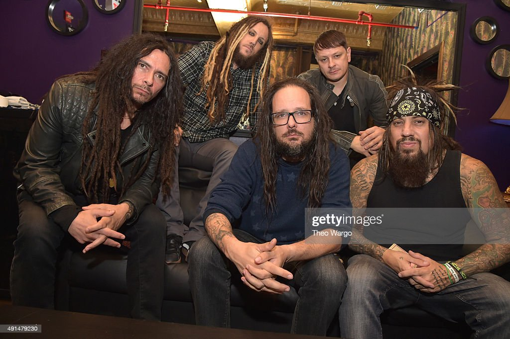 James 'Munky' Schaffer, Brian 'Head' Welch, Jonathan Davis, Ray Luzier and Reginald Quincy 'Fieldy' Arvizu backstage at The Korn 20th Anniversary Tour at Irving Plaza on October 5, 2015 in New York City.