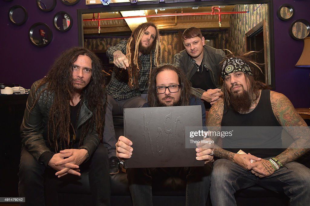 James 'Munky' Schaffer, Brian 'Head' Welch, <a gi-track='captionPersonalityLinkClicked' href=/galleries/search?phrase=Jonathan+Davis&family=editorial&specificpeople=221592 ng-click='$event.stopPropagation()'>Jonathan Davis</a>, <a gi-track='captionPersonalityLinkClicked' href=/galleries/search?phrase=Ray+Luzier&family=editorial&specificpeople=4284387 ng-click='$event.stopPropagation()'>Ray Luzier</a> and Reginald Quincy '<a gi-track='captionPersonalityLinkClicked' href=/galleries/search?phrase=Fieldy&family=editorial&specificpeople=573012 ng-click='$event.stopPropagation()'>Fieldy</a>' Arvizu backstage at The Korn 20th Anniversary Tour at Irving Plaza on October 5, 2015 in New York City.