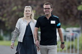 James Murdoch cochief operating officer of News Corp walks with Kathryn Murdoch while arriving for a morning session during the Allen Co Media and...