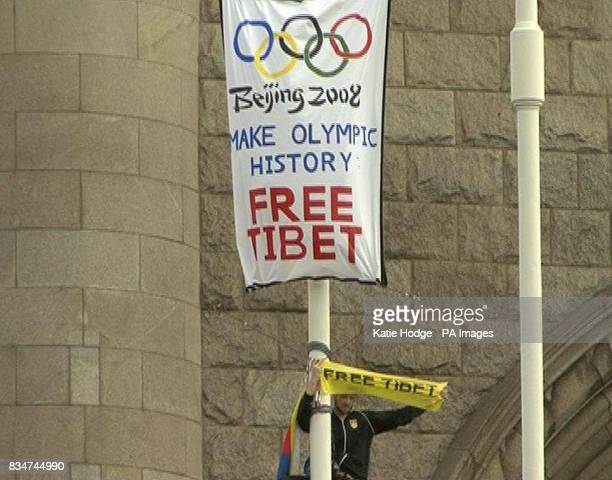 James Murray one of the Students for a Free Tibet unfurl a banner on Tower Bridge in central London protesting against the Chinese regime in Tibet
