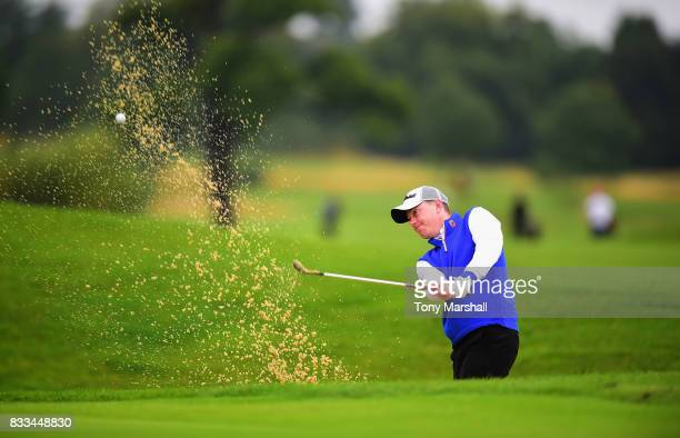 James Mynott of St Ives Golf Club plays out of a bunker on to the 1st green during the Golfbreakscom PGA Fourball Championship Day 2 at Whittlebury...