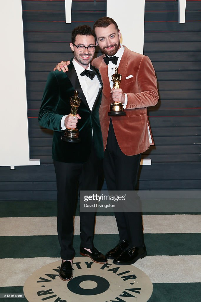 James Napier and Sam Smith arrive at the 2016 Vanity Fair Oscar Party Hosted by Graydon Carter at the Wallis Annenberg Center for the Performing Arts on February 28, 2016 in Beverly Hills, California.