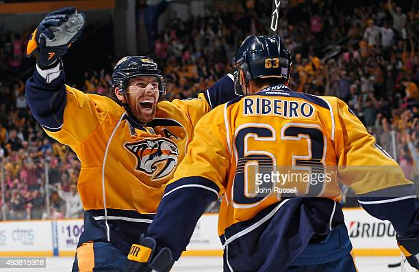 James Neal and Mike Ribeiro of the Nashville Predators celebrate a goal against the Anaheim Ducks during an NHL game at Bridgestone Arena on October...