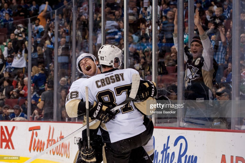 <a gi-track='captionPersonalityLinkClicked' href=/galleries/search?phrase=James+Neal&family=editorial&specificpeople=1487991 ng-click='$event.stopPropagation()'>James Neal</a> #18 and <a gi-track='captionPersonalityLinkClicked' href=/galleries/search?phrase=Sidney+Crosby&family=editorial&specificpeople=212781 ng-click='$event.stopPropagation()'>Sidney Crosby</a> #87 of the Pittsburgh Penguins celebrate the tying goal in the third period against the Vancouver Canucks of on January 7, 2014 at Rogers Arena in Vancouver, British Columbia, Canada.