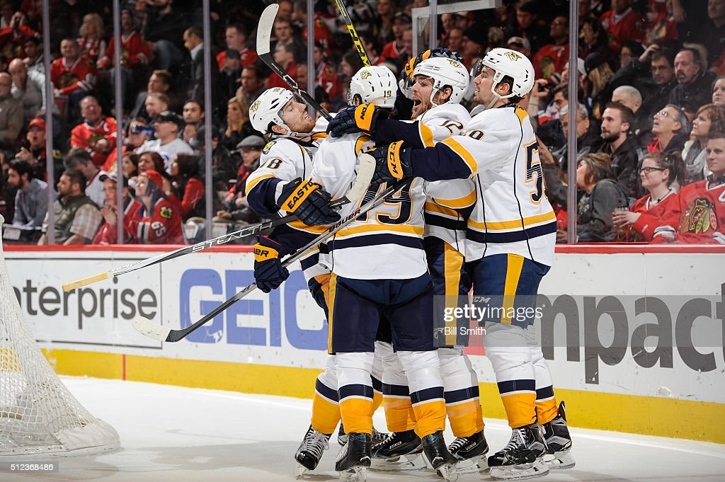 James Neal #18, Calle Jarnkrok #19, Mike Fisher #12 and Roman Josi #59 of the Nashville Predators celebrate after Jarnkrok scored in the third period of the NHL game against the Chicago Blackhawks at the United Center on February 25, 2016 in Chicago, Illinois.