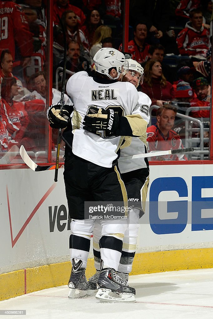 <a gi-track='captionPersonalityLinkClicked' href=/galleries/search?phrase=James+Neal&family=editorial&specificpeople=1487991 ng-click='$event.stopPropagation()'>James Neal</a> #18 celebrates with <a gi-track='captionPersonalityLinkClicked' href=/galleries/search?phrase=Pascal+Dupuis&family=editorial&specificpeople=208971 ng-click='$event.stopPropagation()'>Pascal Dupuis</a> #9 of the Pittsburgh Penguins after scoring a goal in the third period during an NHL game against the Washington Capitals at Verizon Center on November 20, 2013 in Washington, DC.