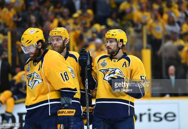 James Neal Mattias Ekholm and Roman Josi of the Nashville Predators look on during a break in play in the second period of Game Six of the 2017 NHL...