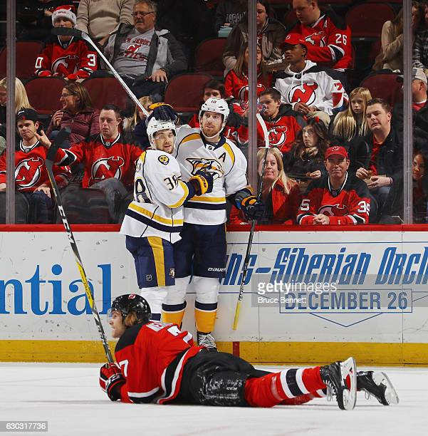 James Neal of the Nashville Predators celebrates his goal at 543 of the first period against the New Jersey Devils and is joined by Viktor Arvidsson...