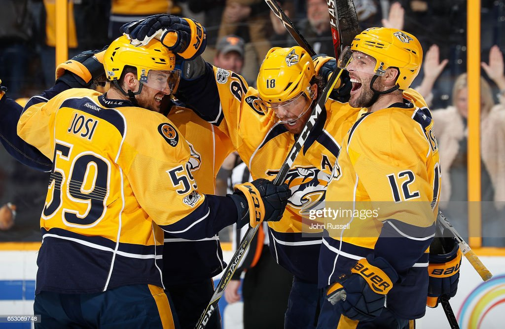 James Neal #18 of the Nashville Predators celebrates his overtime game winning goal with Roman Josi #59 and Mike Fisher #12 against the Winnipeg Jets during an NHL game at Bridgestone Arena on March 13, 2017 in Nashville, Tennessee.