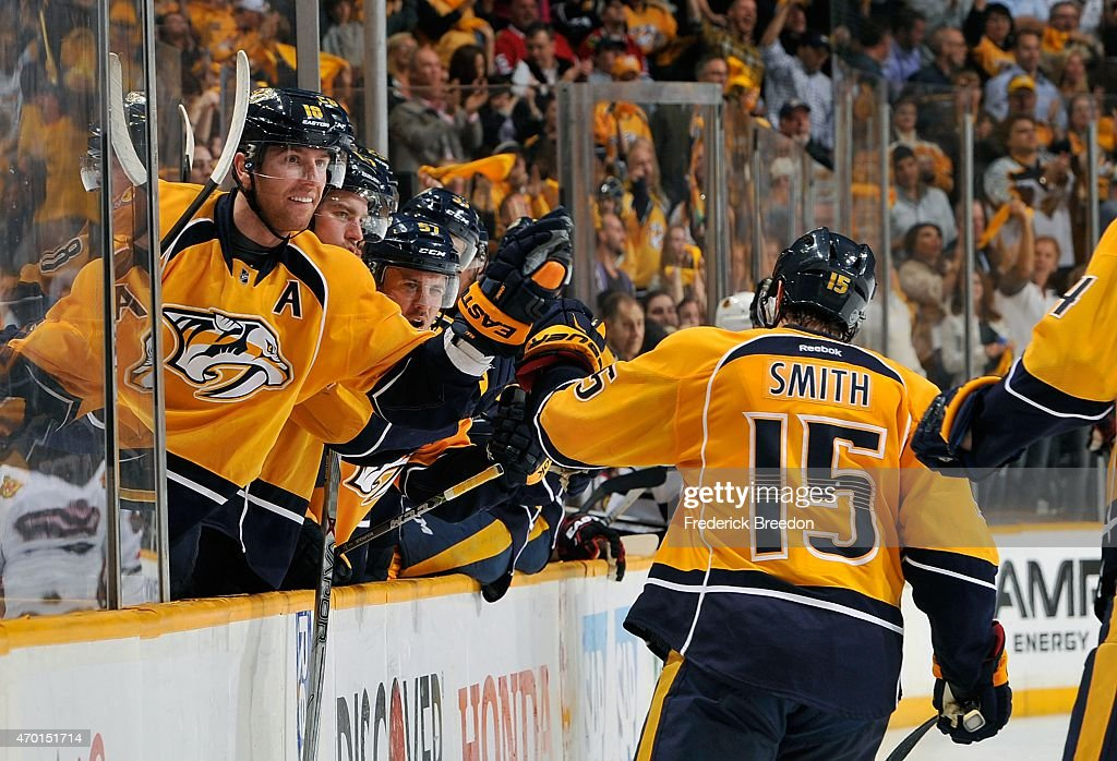 James Neal #18 of the Nashville Predators congratulates teammate Craig Smith #15 on scoring a goal against the Chicago Blackhawks in the second period of Game Two of the Western Conference Quarterfinals during the 2015 NHL Stanley Cup Playoffs at Bridgestone Arena on April 17, 2015 in Nashville, Tennessee.
