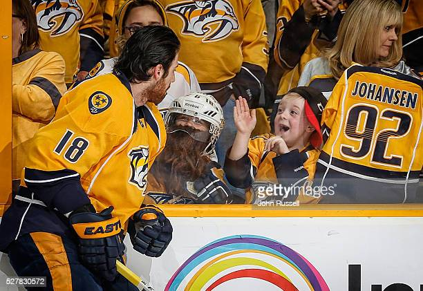 James Neal of the Nashville Predators has some fun with young fans in warmups prior to Game Three of the Western Conference Second Round against the...