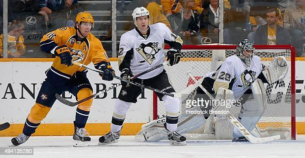 James Neal of the Nashville Predators is defended by Ben Lovejoy of the Pittsburgh Penguins in front of goalie Ian Cole during the second period at...