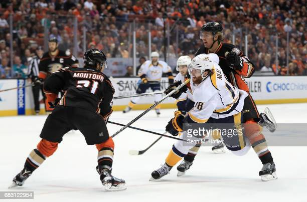James Neal of the Nashville Predators skates to the net against Hampus Lindholm and Brandon Montour of the Anaheim Ducks in the second period of Game...