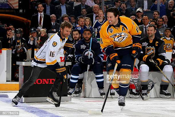 James Neal of the Nashville Predators skates with country music artist Dierks Bentley during the 2016 Honda NHL AllStar Skill Competition at...
