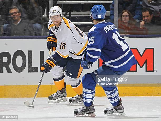 James Neal of the Nashville Predators skates with the puck against the Toronto Maple Leafs during an NHL game at the Air Canada Centre on February 23...