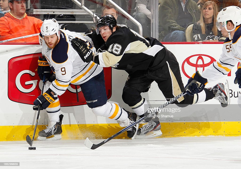 <a gi-track='captionPersonalityLinkClicked' href=/galleries/search?phrase=James+Neal&family=editorial&specificpeople=1487991 ng-click='$event.stopPropagation()'>James Neal</a> #18 of the Pittsburgh Penguins battles for the puck against <a gi-track='captionPersonalityLinkClicked' href=/galleries/search?phrase=Steve+Ott&family=editorial&specificpeople=210616 ng-click='$event.stopPropagation()'>Steve Ott</a> #9 of the Buffalo Sabres on April 2, 2013 at Consol Energy Center in Pittsburgh, Pennsylvania. Buffalo won the game 4-1.