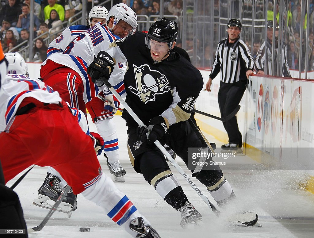 James Neal #18 of the Pittsburgh Penguins battles for the puck in front of Anton Stralman #6 of the New York Rangers on February 7, 2014 at Consol Energy Center in Pittsburgh, Pennsylvania.