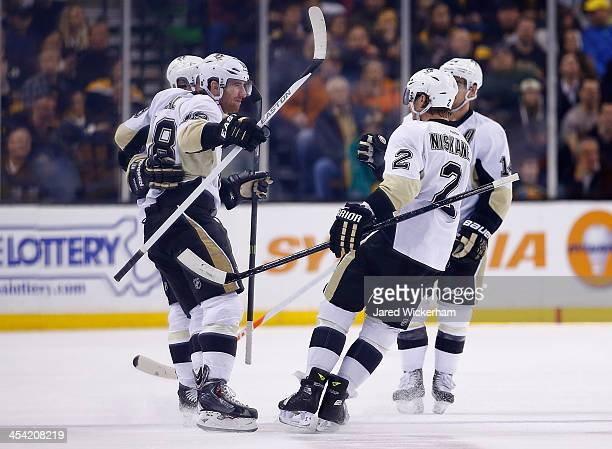 James Neal of the Pittsburgh Penguins celebrates his goal in the first period with teammates including Matt Niskanen against the Boston Bruins during...