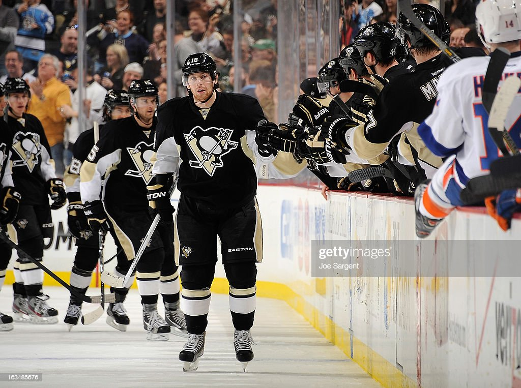 <a gi-track='captionPersonalityLinkClicked' href=/galleries/search?phrase=James+Neal&family=editorial&specificpeople=1487991 ng-click='$event.stopPropagation()'>James Neal</a> #18 of the Pittsburgh Penguins celebrates his goal with the bench during the game against the New York Islanders on March 10, 2013 at Consol Energy Center in Pittsburgh, Pennsylvania.