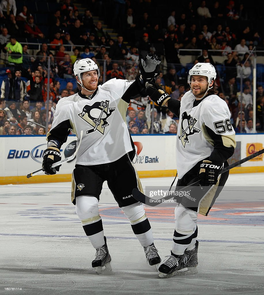 James Neal #18 (L) of the Pittsburgh Penguins celebrates his powerplay goal at 2:58 of the first period against the New York Islanders along with defenseman Kris Letang #58 at the Nassau Veterans Memorial Coliseum on February 5, 2013 in Uniondale, New York.