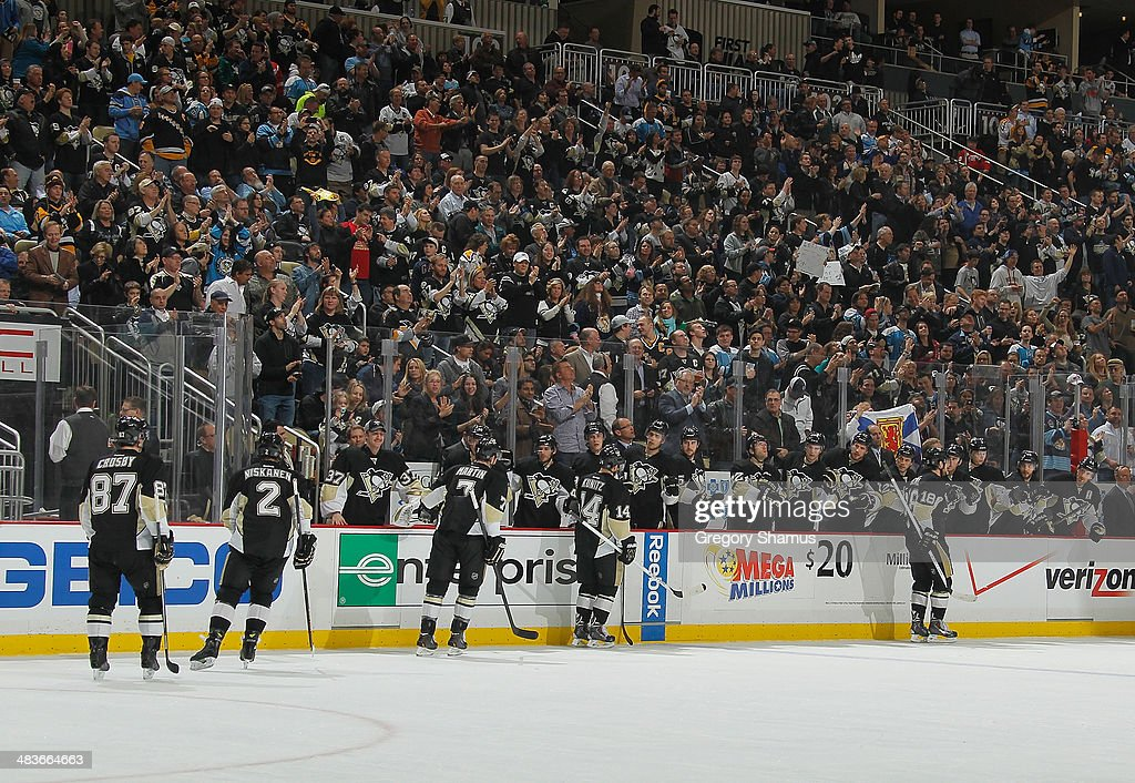 James Neal #18 of the Pittsburgh Penguins celebrates his second goal with the bench during the second period against the Detroit Red Wings on April 9, 2014 at Consol Energy Center in Pittsburgh, Pennsylvania.