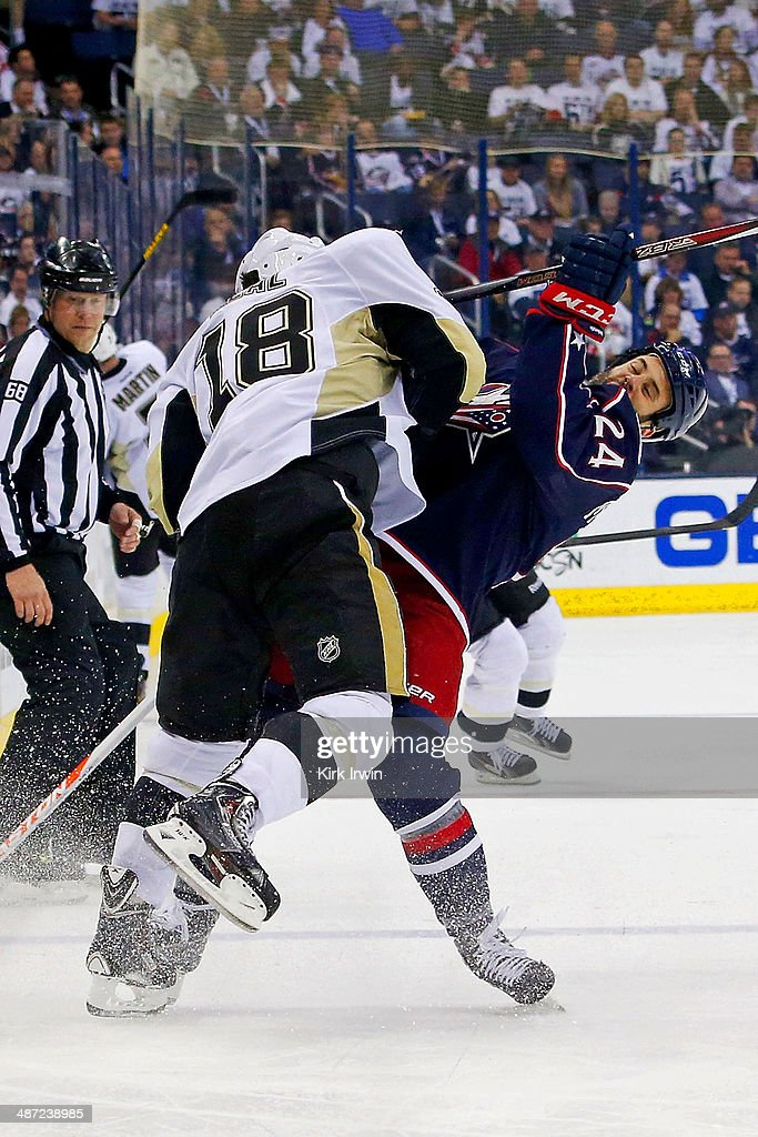<a gi-track='captionPersonalityLinkClicked' href=/galleries/search?phrase=James+Neal&family=editorial&specificpeople=1487991 ng-click='$event.stopPropagation()'>James Neal</a> #18 of the Pittsburgh Penguins collides with Derek Mackenzie #24 of the Columbus Blue Jackets while chasing after the puck during the third period of Game Six of the First Round of the 2014 NHL Stanley Cup Playoffs at Nationwide Arena on April 28, 2014 in Columbus, Ohio. Pittsburgh defeated Columbus 4-3 to win the series four games to two.