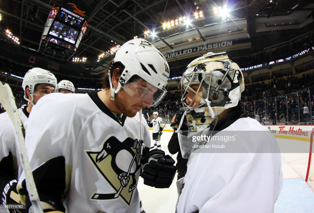 James Neal #18 of the Pittsburgh Penguins congratulates goaltender Marc-Andre Fleury #29 following a 3-1 victory over the Winnipeg Jets at the MTS Centre on February 15, 2013 in Winnipeg, Manitoba, Canada.