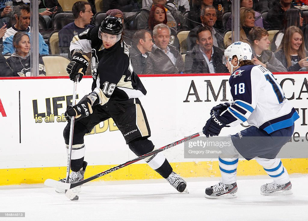 James Neal #18 of the Pittsburgh Penguins controls the puck in front of Bryan Little #18 of the Winnipeg Jets on March 28, 2013 at Consol Energy Center in Pittsburgh, Pennsylvania. Pittsburgh won the game 4-0.