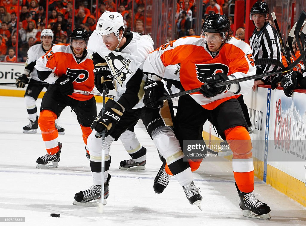 James Neal #18 of the Pittsburgh Penguins fights for the puck with Braydon Coburn #5 of the Philadelphia Flyers at Wells Fargo Center on January 19, 2013 in Philadelphia, Pennsylvania.