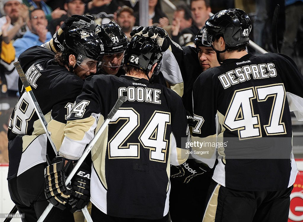 <a gi-track='captionPersonalityLinkClicked' href=/galleries/search?phrase=James+Neal&family=editorial&specificpeople=1487991 ng-click='$event.stopPropagation()'>James Neal</a> #18 of the Pittsburgh Penguins is congratulated by teammates after his second goal of the game during the third period against the Ottawa Senators on February 13, 2013 at Consol Energy Center in Pittsburgh, Pennsylvania.