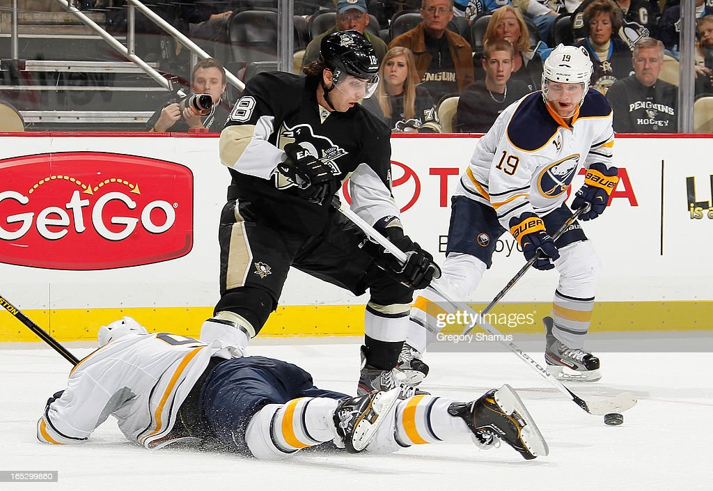 <a gi-track='captionPersonalityLinkClicked' href=/galleries/search?phrase=James+Neal&family=editorial&specificpeople=1487991 ng-click='$event.stopPropagation()'>James Neal</a> #18 of the Pittsburgh Penguins moves the puck between the defense of <a gi-track='captionPersonalityLinkClicked' href=/galleries/search?phrase=Steve+Ott&family=editorial&specificpeople=210616 ng-click='$event.stopPropagation()'>Steve Ott</a> #9 and <a gi-track='captionPersonalityLinkClicked' href=/galleries/search?phrase=Cody+Hodgson&family=editorial&specificpeople=4151192 ng-click='$event.stopPropagation()'>Cody Hodgson</a> #19 of the Buffalo Sabres on April 2, 2013 at Consol Energy Center in Pittsburgh, Pennsylvania. Buffalo won the game 4-1.