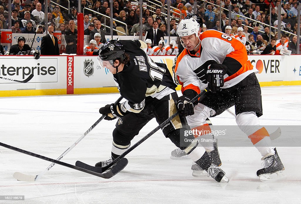 James Neal #18 of the Pittsburgh Penguins moves the puck in front of Mike Knuble #9 of the Philadelphia Flyers on February 20, 2013 at Consol Energy Center in Pittsburgh, Pennsylvania.