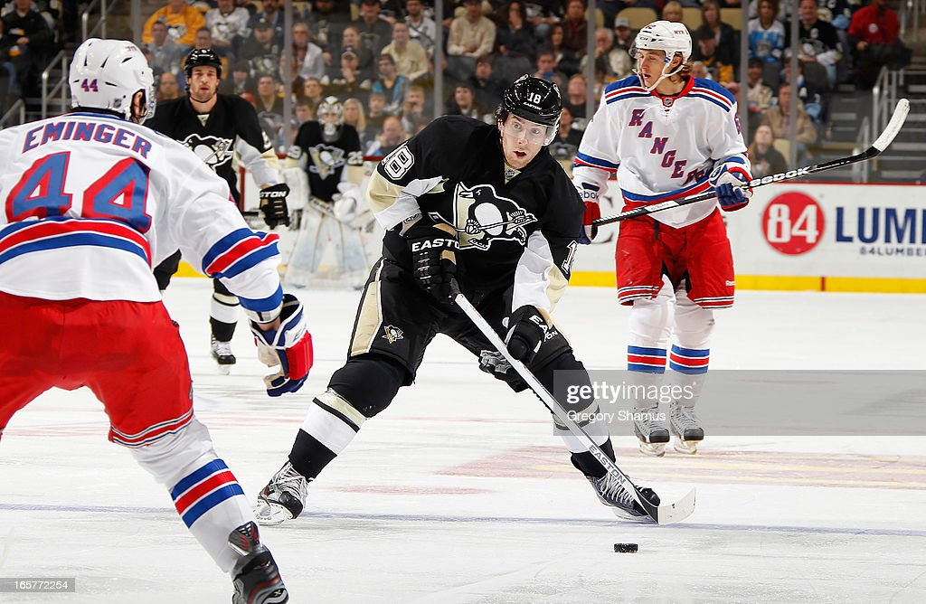 James Neal #18 of the Pittsburgh Penguins moves the puck in front of Steve Eminger #44 of the New York Rangers on April 5, 2013 at Consol Energy Center in Pittsburgh, Pennsylvania.