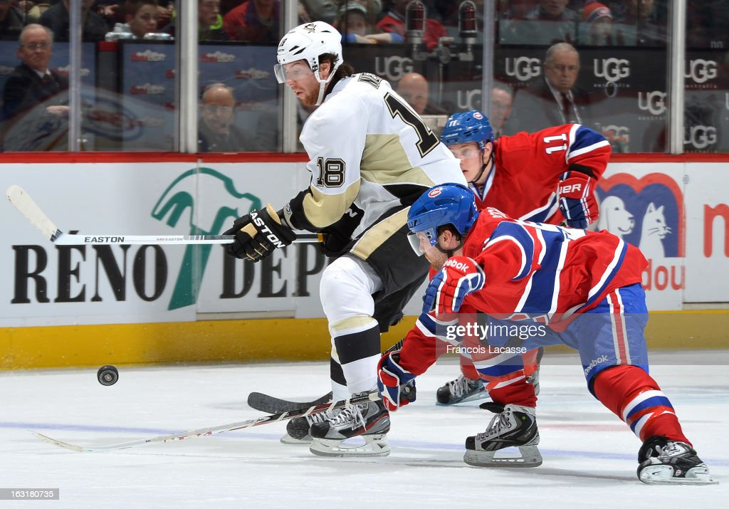 James Neal #18 of the Pittsburgh Penguins moves to the puck followed by David Desharnais #51 of the Montreal Canadiens during the NHL game on March 2, 2013 at the Bell Centre in Montreal, Quebec, Canada.