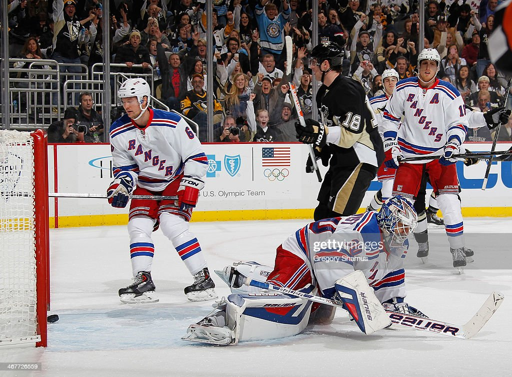 James Neal #18 of the Pittsburgh Penguins reacts after his goal in front of Anton Stralman #6 and Henrik Lundqvist #30 of the New York Rangers on February 7, 2014 at Consol Energy Center in Pittsburgh, Pennsylvania.