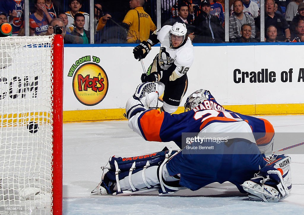 James Neal #18 of the Pittsburgh Penguins scores at 14:50 of the first period against <a gi-track='captionPersonalityLinkClicked' href=/galleries/search?phrase=Evgeni+Nabokov&family=editorial&specificpeople=171380 ng-click='$event.stopPropagation()'>Evgeni Nabokov</a> #20 of the New York Islanders in Game Four of the Eastern Conference Quarterfinals during the 2013 NHL Stanley Cup Playoffs at the Nassau Veterans Memorial Coliseum on May 7, 2013 in Uniondale, New York.