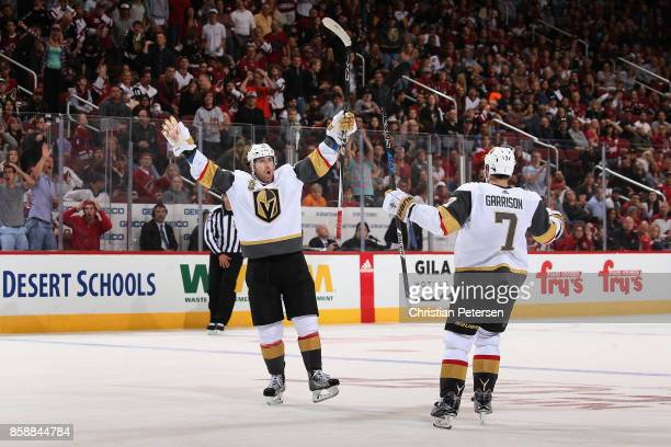 James Neal of the Vegas Golden Knights celebrates alongside Jason Garrison after Neal scored the game winning goal in overtime of the NHL game...