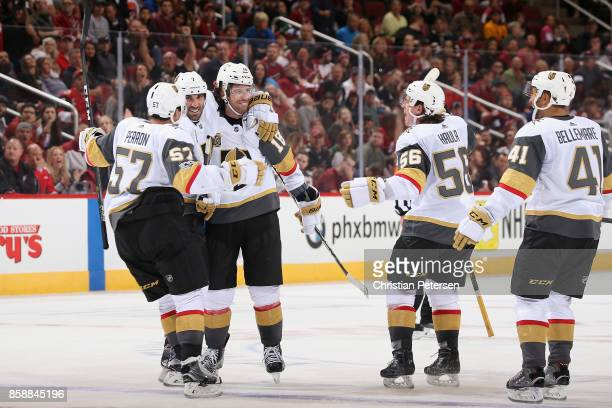 James Neal of the Vegas Golden Knights celebrates with David Perron Jason Garrison Erik Haula and PierreEdouard Bellemare after Neal scored the game...