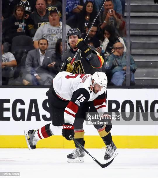 James Neal of the Vegas Golden Knights checks Brad Richardson of the Arizona Coyotes during the second period during the Golden Knights' inaugural...