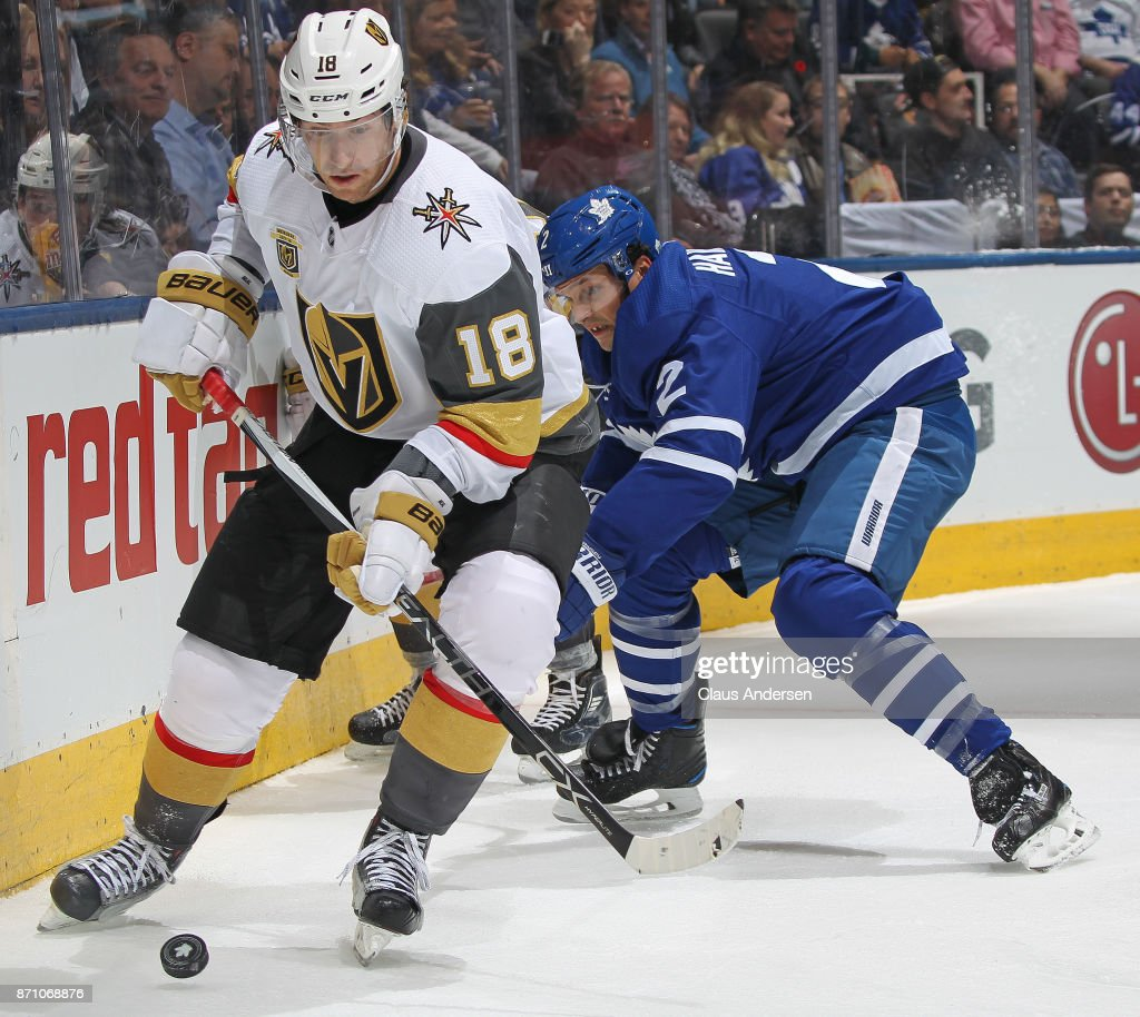 James Neal #18 of the Vegas Golden Knights skates the puck against Ron Hainsey #2 of the Toronto Maple Leafs during an NHL game at the Air Canada Centre on November 6, 2017 in Toronto, Ontario, Canada. The Maple Leafs defeated the Golden Knights 4-3 in an overtime shoot-out.