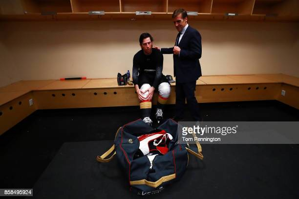 James Neal of the Vegas Golden Knights talks with Vegas Golden Knights general manager George McPhee in the locker room after scoring the first two...