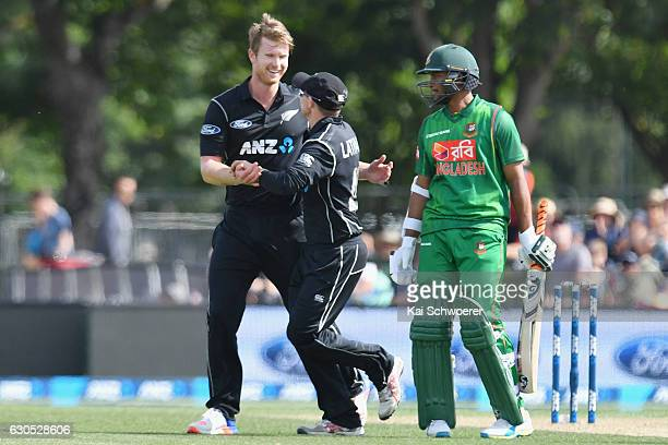James Neesham of New Zealand is congratulated by Tom Latham of New Zealand after dismissing Tamim Iqbal of Bangladesh during the first One Day...