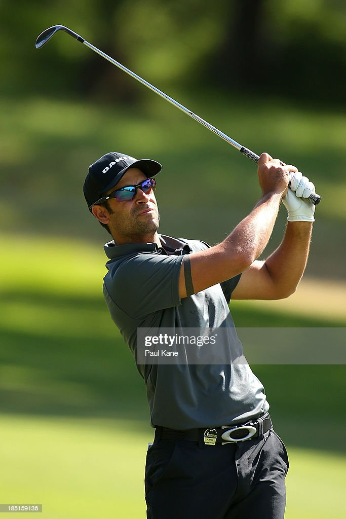 <a gi-track='captionPersonalityLinkClicked' href=/galleries/search?phrase=James+Nitties&family=editorial&specificpeople=220320 ng-click='$event.stopPropagation()'>James Nitties</a> of Australia watches his approach shot on the 10th hole during day two of the Perth International at Lake Karrinyup Country Club on October 18, 2013 in Perth, Australia.