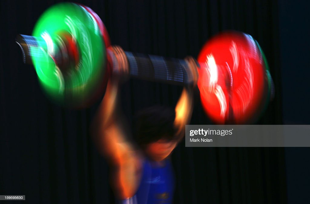James Norman of Australia B competes in the Men's 62kg Weightlifting during day two of the 2013 Australian Youth Olympic Festival at St Ignatius College on January 17, 2013 in Sydney, Australia.