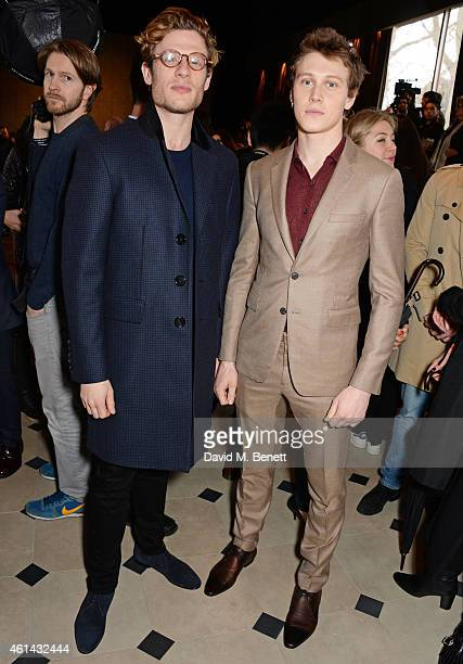 James Norton and George Mackay attend the front row at Burberry Prorsum AW15 London Collections Men at Kensington Gardens on January 12 2015 in...