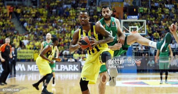 James Nunnally #21 of Fenerbahce Istanbul competes with Ioannis Bourousis #29 of Panathinaikos Superfoods Athens during the 2016/2017 Turkish...